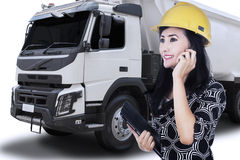Beautiful engineer talking with phone Royalty Free Stock Photo