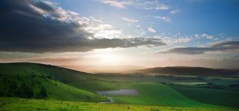 Beautiful English countryside landscape. Stunning landscape at sunset over rolling English countryside Stock Photos