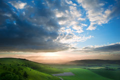 Beautiful English countryside landscape. Stunning landscape at sunset over rolling English countryside Royalty Free Stock Images