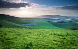 Beautiful English countryside landscape. Stunning landscape at sunset over rolling English countryside Royalty Free Stock Photography