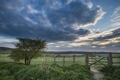 Beautiful English countryside landscape over fields at sunset. Stunning English countryside landscape over fields at sunset Royalty Free Stock Images