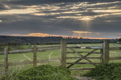 Beautiful English countryside landscape over fields at sunset. Stunning English countryside landscape over fields at sunset Royalty Free Stock Image