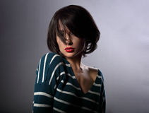 Beautiful enjoing woman moving and shaking her short black hair Stock Photo