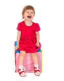 Beautiful enjoy a nice little girl is sitting on a chair Stock Photo