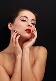 Beautiful enjoying makeup woman touching her health face skin Royalty Free Stock Image
