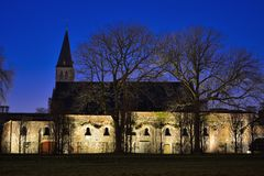 Beautiful enlightened abby wall and church Stock Photography