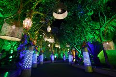Beautiful entrance with artistic lamps, lights and green plants royalty free stock images