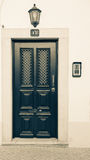 Beautiful entrance door, a lantern and a number 13 on the light Stock Image