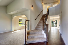 Beautiful entry way with carpet staircase. Royalty Free Stock Photos