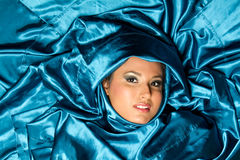Beautiful ethnic girl wrapped in satin material Royalty Free Stock Photo