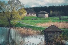 Beautiful ethnic houses on rural landscape - birthplace of Kosciuszko, Belarus. Royalty Free Stock Photography