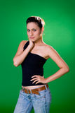 Beautiful eurasian girl. A casual beautifule eurasian girl in jeans and one strap top Stock Photography