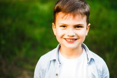 A beautiful European boy is smiling and looking at the camera. royalty free stock photo