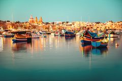 Beautiful european harbor with maltese yacht and boat luzzu, vil. Lage of Marsaxlokk, vintage toned style Royalty Free Stock Photography