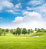 Beautiful european landscape. Spring green field and blue sky Stock Photos