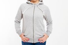 Beautiful european mid aged woman dressed in a light grey casual hooded jacket - studio shot in front of a white background royalty free stock photo