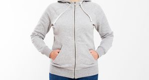Beautiful european mid aged woman dressed in a light grey casual hooded jacket - studio shot in front of a white background royalty free stock image