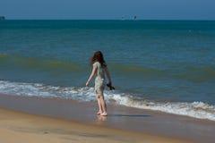 Free Beautiful European Tourist Woman Walking Near Ocean On The Beach Stock Images - 142181214