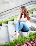 Beautiful european woman sitting om steps Royalty Free Stock Images