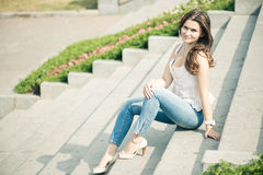 beautiful european woman sitting om steps Stock Image