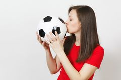 Beautiful European young people, football fan or player on white background. Sport, play, health, healthy lifestyle concept. royalty free stock image