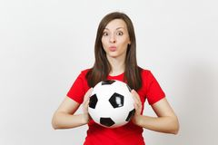 Beautiful European young people, football fan or player on white background. Sport, play, health, healthy lifestyle concept. stock photos