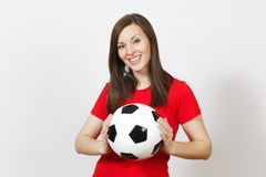 Beautiful European young people, football fan or player on white background. Sport, play, health, healthy lifestyle concept. Beautiful European young cheerful royalty free stock photo