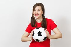 Beautiful European young people, football fan or player on white background. Sport, play, health, healthy lifestyle concept. Smiling European young woman, two Stock Photo