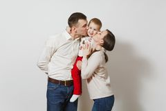 Beautiful European young people on a white background. Emotions, family concept. Joyful smiling young man, women holding, kissing, hugging little cute child boy stock images