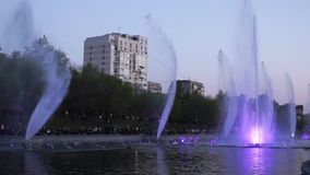 A beautiful evening cityscape with illuminated fountain Ussuriysky in the lower city pond, KHABAROVSK, RUSSIA stock video footage