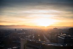 Dublin cityscape, sunset over office buildings and church. Beautiful evening over Dublin, orange sky, violet shadows over the city Royalty Free Stock Image
