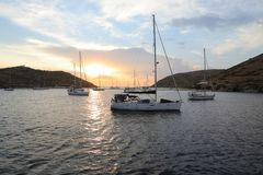 Beautiful evening and sailboats in Kolona double bay Kythnos island Cyclades Greece. Travel destinations September 2018. Horizontal royalty free stock photography