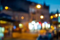 Beautiful evening scenery of european town. Street with bright lanterns. abstract blur background. bokeh effect royalty free stock photos
