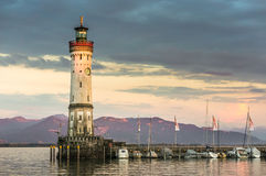 Beautiful evening seascape with lighthouse in harbor of Lindau Stock Photo