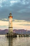 Beautiful evening seascape with lighthouse in harbor of Lindau Royalty Free Stock Photo