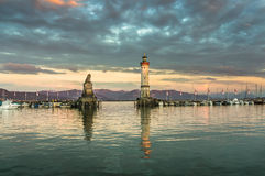 Beautiful evening seascape with lighthouse in harbor of Lindau Stock Images
