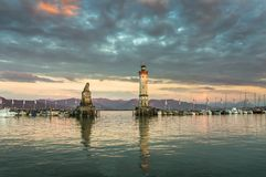 Beautiful evening seascape with lighthouse in harbor of Lindau Royalty Free Stock Images