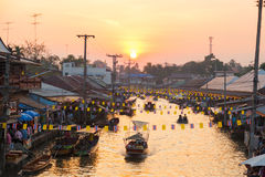 Beautiful evening with sunset at Ampawa floating market stock photo