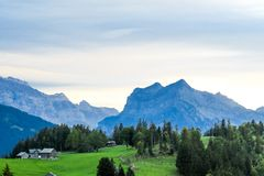 Alpine scene in the Swiss mountains: Sunset and storm clouds stock photo