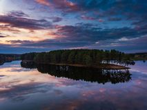 Beautiful evening view of lake and island royalty free stock photos