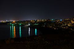 Beautiful evening view from sea for city in night illumination Royalty Free Stock Photography