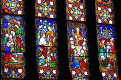 Beautiful example of the craftsmanship in stained glass windows on dark background. Gorgeous detail in four colorful glass panes of stained glass windows that Royalty Free Stock Photo