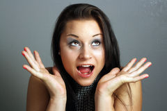 Beautiful Excited Brunette (1). Close-up of a lovely excited brunette, looking toward upper frame right Stock Image
