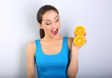 Beautiful excited fun young healthy woman with opened mouth hold Stock Images