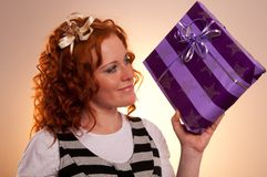 Beautiful excited girl with a presents Stock Photos