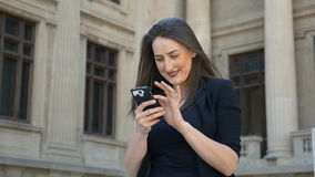 Beautiful excited girl sending selfie and chatting on social media stock footage