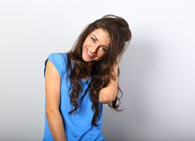 Beautiful excited laughing woman looking with happy smile in blu stock photography