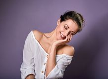 Beautiful excited laughing woman in white shirt covering the mouth the hands. Closeup portrait on empty purple copy space. Closeup stock photos