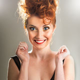 Beautiful excited red-haired girl Royalty Free Stock Images