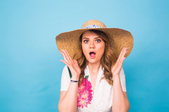 Beautiful excited surprised young woman over blue background with copy space. Beautiful excited surprised young woman over blue background with copy space Royalty Free Stock Photos